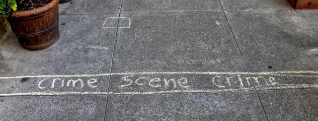 A child's chalk drawing maps out book theft crime scene
